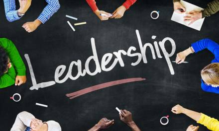 How do pastoral and academic leaders differ in their approach to school management?